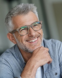 Middle-aged man in grey shirt with perfect smile