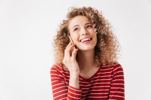 woman smiling speaking on the phone